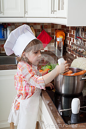 Little girl plays the cook