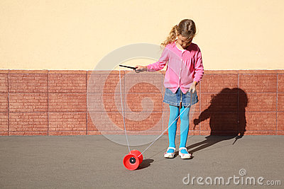 Little girl plays with yo-yo