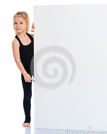 Free Little Girl Points A Finger At A White Banner. Stock Photography - 117425932