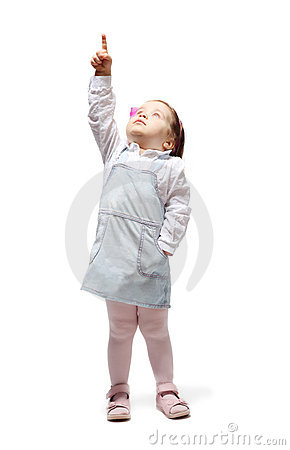 Free Little Girl Points Finger Up And Looks Up Stock Images - 18848354