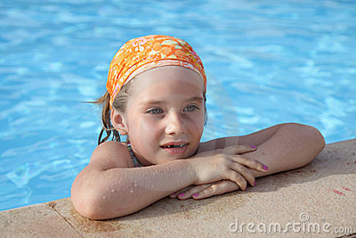 Little girl in pool.