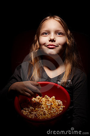 Little girl with popcorn