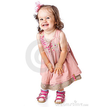 A little girl is posing