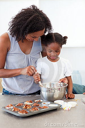 Little Girl Preparing Biscuits With Her Mother Royalty Free Stock Photo - Image: 12402005