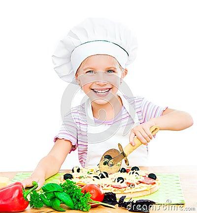 Little girl preparing a pizza