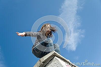 Little girl preparing to a big jump
