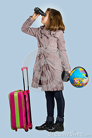 Little girl is preparing to travel