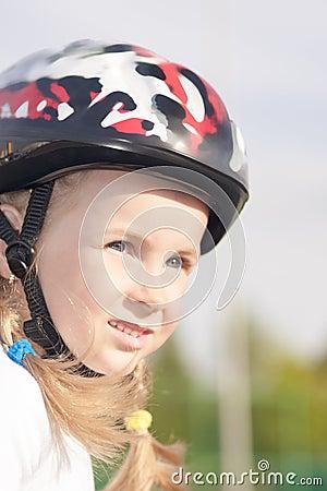 Little girl in protective helmet