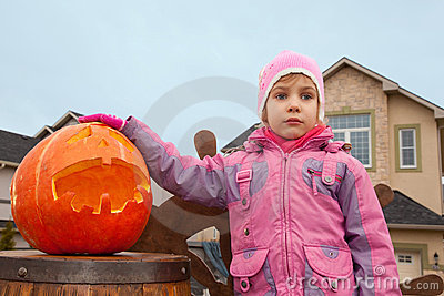 Little girl and pumpkin of Halloween