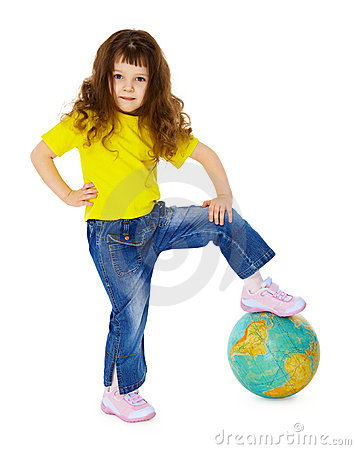 Little girl put her foot on geographic globe
