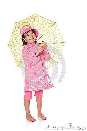 Little girl with raincoat and umbrella