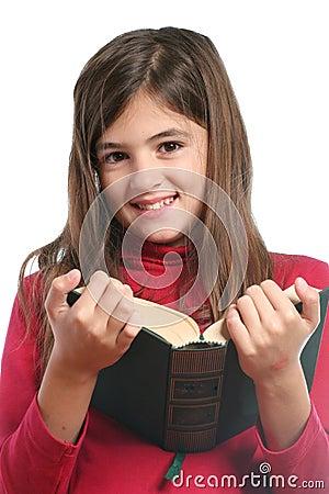 Little girl read a book