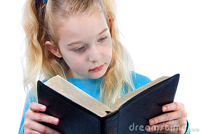 Little girl is reading the Bible