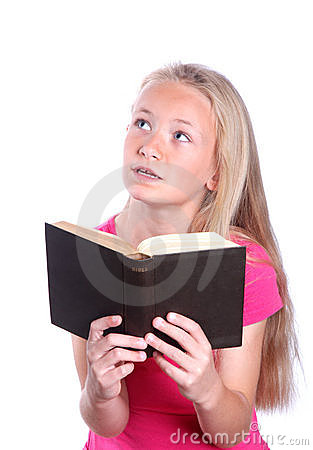Little girl reading bible on white Stock Photo