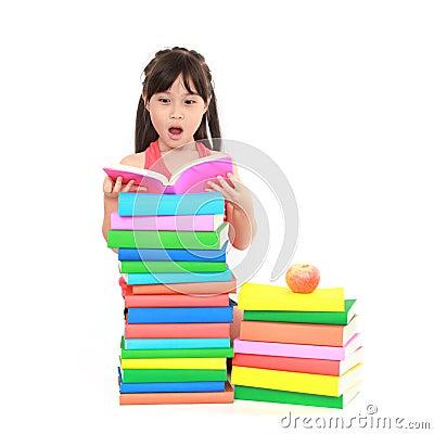 Little girl reading the book