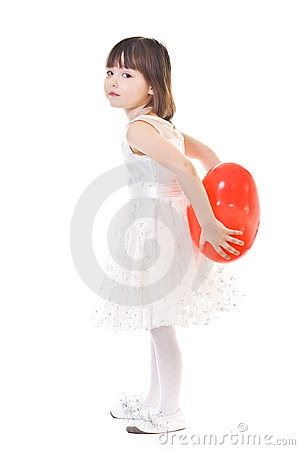 Little girl with red balloon behind her back