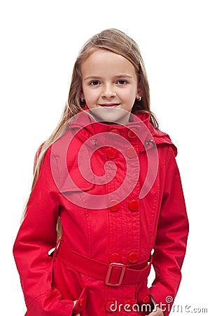 Little girl in red coat