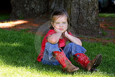 Little girl with red cowboy boots