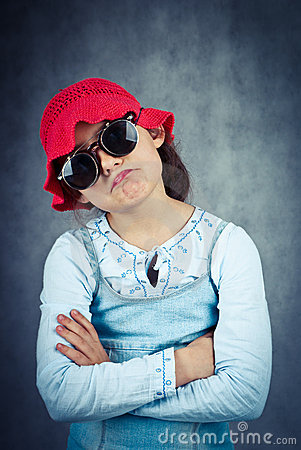 Little girl in red hat and sunglasses disappointed