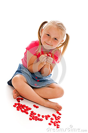 Little girl with red hearts
