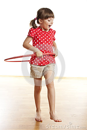 Little girl with a red hoop