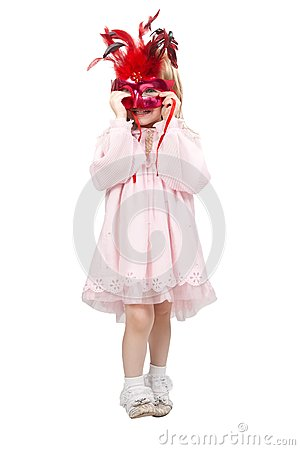 Little girl in a red mask in studio