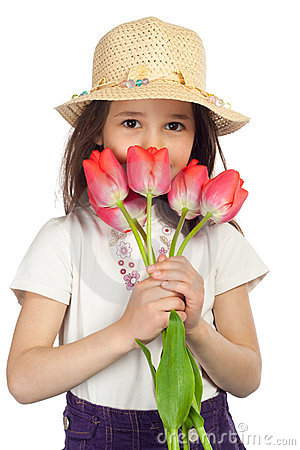Little girl with red tulips
