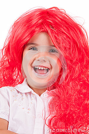 Little girl with red wigs