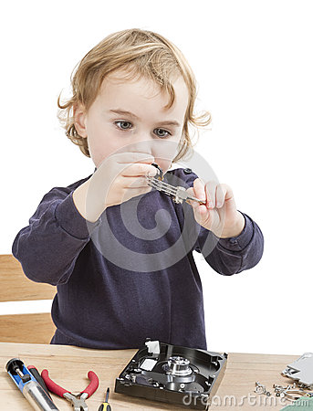 Little girl repairing computer parts
