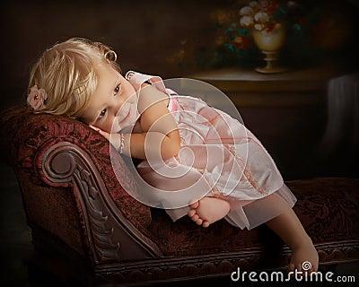 little girl resting on settee