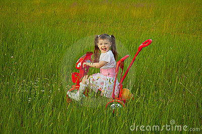 Little Girl Rides A Bicycle On Field Royalty Free Stock Photo - Image: 15203725
