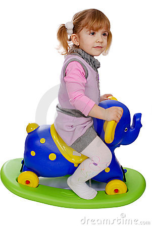 Little girl riding elephant toy