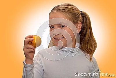 Little girl with ripe lemon