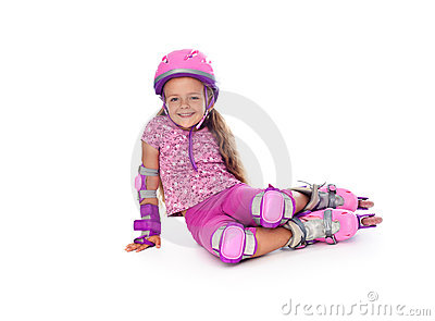 Little girl with roller skates resting