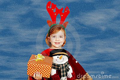 Little girl with rudolf deer horn and gift