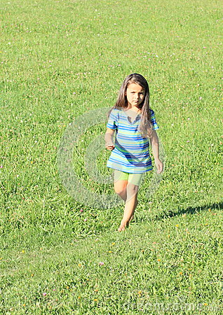 Little girl running barefoot