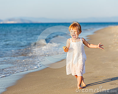 Little girl running on the beach