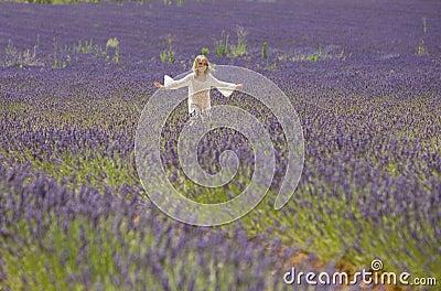 Little girl runs in lavender field
