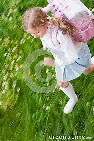 Little girl rushing to school