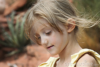 A Little Girl s Wispy Hair Blows in the Breeze