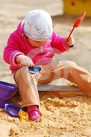 The little girl in a sandbox