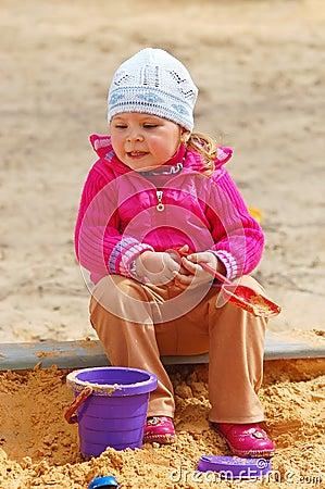 The little girl in a sandbox