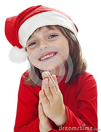 Little girl with a santa cap