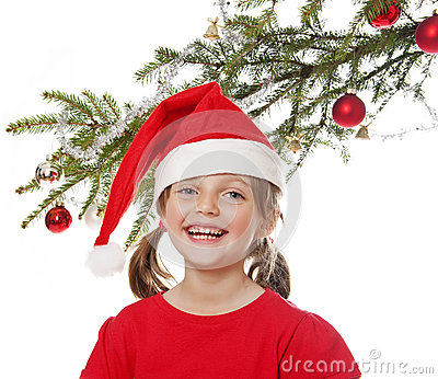 Little girl with santa cap and christmas tree