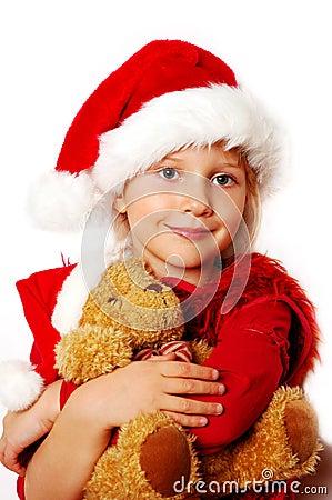 Little girl in santa cloth with teddy bear