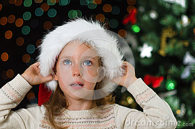 Little girl in santa s hat