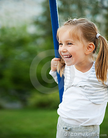 Little girl on  seesaw