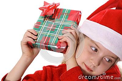 Little girl shaking present