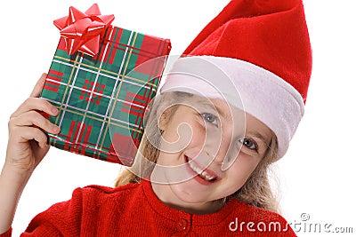 Little girl shaking present smile