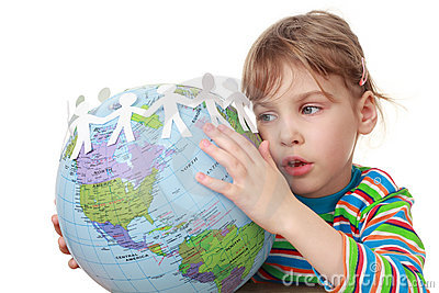 Little girl in shirt play with globe